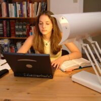 Girl using the SADelite desk lamp