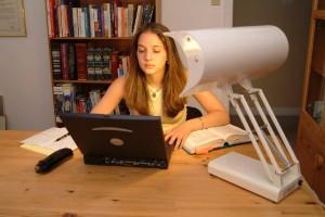 Girl using the SADelite desk lamp